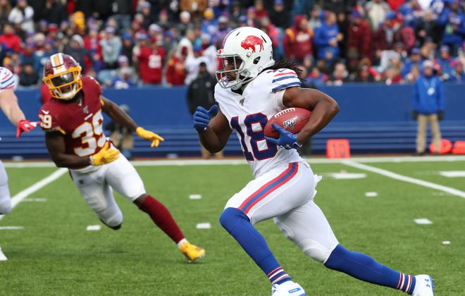 Andre Roberts breaks a long kickoff return against Redskins player Jeremy Reaves. (James P. McCoy/News file photo)