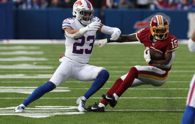 Buffalo Bills strong safety Micah Hyde (23) tackles Washington Redskins wide receiver Steven Sims (15) in the second quarter at New Era Field on Sunday, Nov. 3, 2019. (James P. McCoy/Buffalo News)