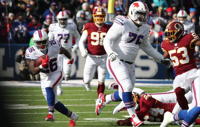 Devin Singletary (26) rushes against the Washington Redskins. (James P. McCoy/Buffalo News)