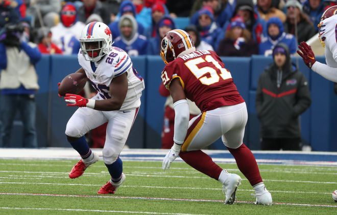Buffalo Bills running back Devin Singletary (26) rushes for first down over Washington Redskins linebacker Shaun Dion Hamilton (51) in the third quarter at New Era Field in Orchard Park, NY on Sunday, Nov. 3, 2019.  James P. McCoy/Buffalo News