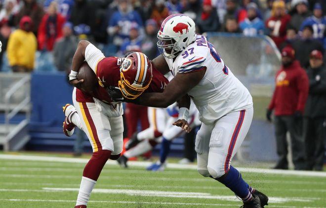 Buffalo Bills defensive tackle Jordan Phillips (97) sacks Washington Redskins quarterback Dwayne Haskins (7) in the fourth quarter at New Era Field on Sunday, Nov. 3, 2019. (James P. McCoy/Buffalo News)