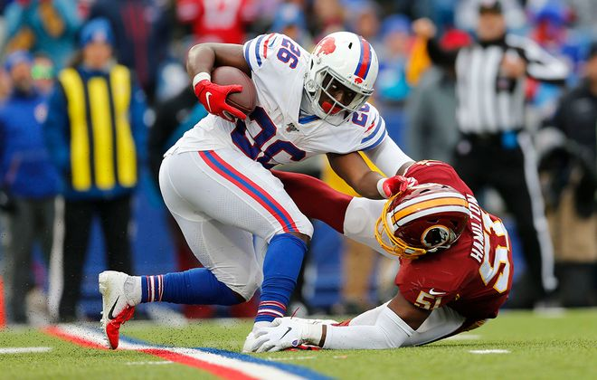 Bills running back Devin Singletary breaks a tackle attempt by Redskins linebacker Shaun Dion Hamilton. (Derek Gee/Buffalo News)
