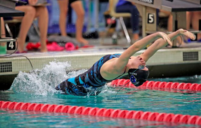 Frewsburg swimmer Madison Kramer starts and wins the Girls 100 Yard Backstroke with a time of 30.59 at the Section VI Class C swimming championship at the Burt Flickinger Center on Friday, Nov. 1, 2019.  (Harry Scull Jr./Buffalo News)