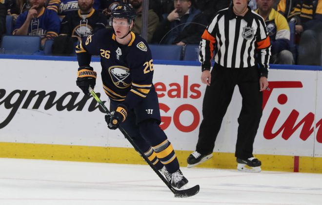 Buffalo Sabres defenseman Rasmus Dahlin (26) skates with the puck in the first period at Key Bank Center in Buffalo, NY on Thursday, Nov. 14, 2019.  James P. McCoy/Buffalo News
