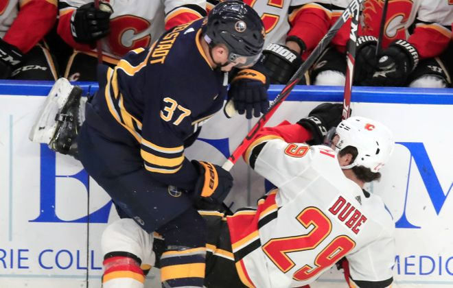 Buffalo Sabres forward Casey Mittelstadt checks Calgary Flames player Dillon Dube during the first period at the KeyBank Center on Wednesday, Nov. 27, 2019.  (Harry Scull Jr./Buffalo News)
