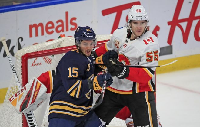 Buffalo Sabres forward Jean-Sebastien-Dea battles for position with Calgary Flames defenseman Noah Hanifin during the second period at KeyBank Center on Wednesday, Nov. 27, 2019.  (Harry Scull Jr./Buffalo News)