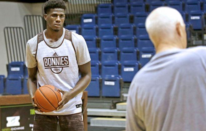 St. Bonaventure forward Amadi Ikpeze listens to coach Mark Schmidt during a recent practice. (Robert Kirkham/Buffalo News)