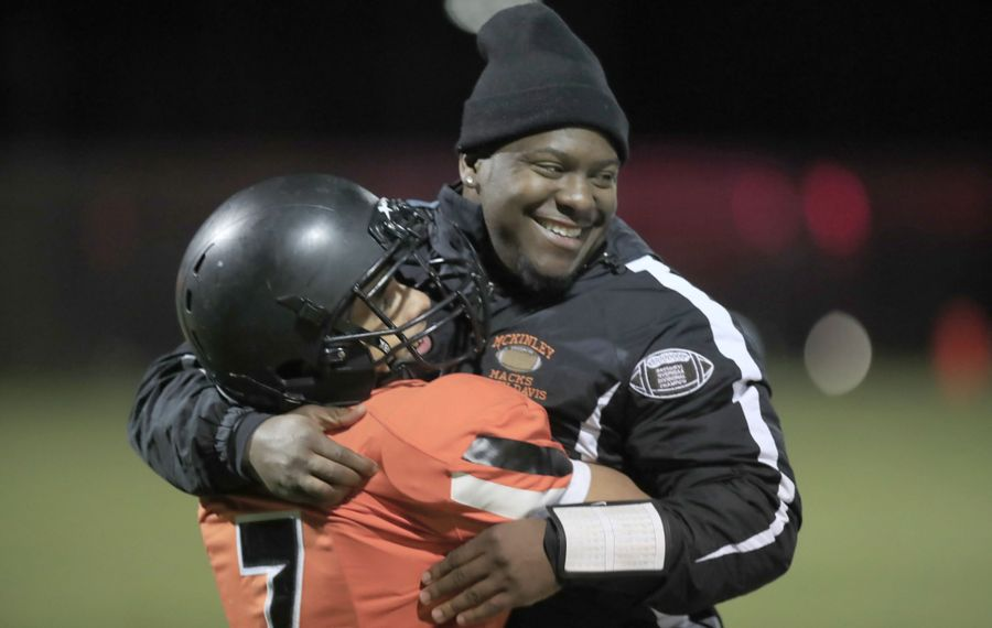 McKinley coach Brian Davis celebrates a 7-0 victory over West Seneca West with Takeo Funderburk at Riverside's Dingboom Field. (Harry Scull Jr./Buffalo News)