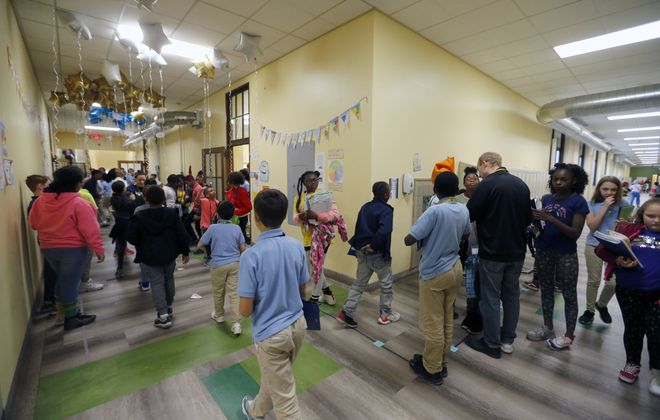 The city's traditional public schools might be able to learn something from how  Buffalo Academy of Science Charter School educates a similar student demographic. (Mark Mulville/News file photo)