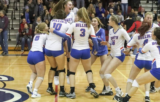 Williamsville South's  Julia Barr celebrates with her teammates after the Billies rallied to win the Section VI Class A volleyball title. (James P. McCoy/Buffalo News)