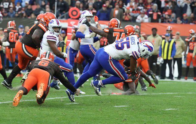 Bills defensive end Jerry Hughes picks up a botched shovel pass by Cleveland Browns quarterback Baker Mayfield. (James P. McCoy/Buffalo News)