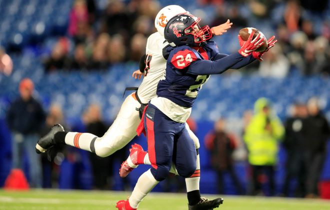 Southwestern receiver Zishaun Munir makes a catch against Wilson during the Section VI Football Class C Final at New Era Field on Saturday. (Harry Scull Jr./Buffalo News)
