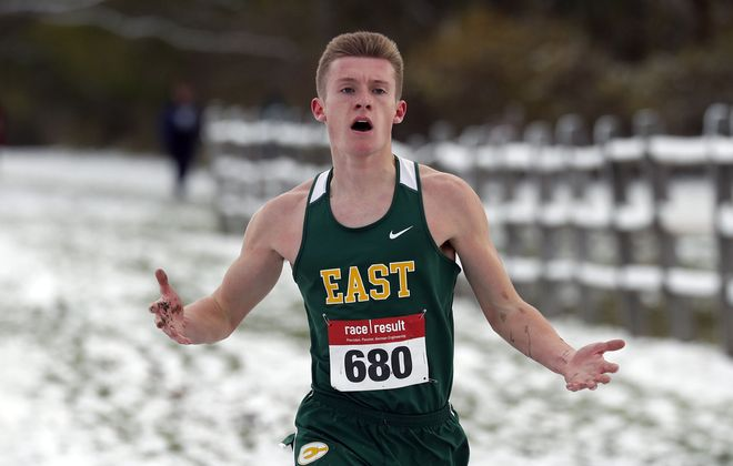 West Seneca East's Vinny Pagciaccio wins the Boys Class B Race during the Section VI Cross Country Meet at Knox Farm State Park in East Aurora Friday. (Mark Mulville/Buffalo News)