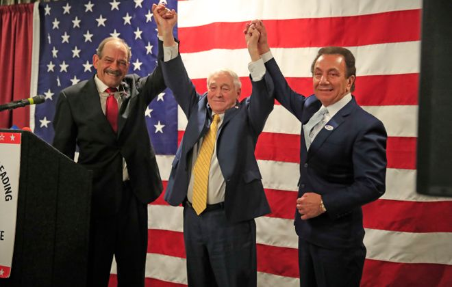 Erie County GOP Chairman Karl Simmeth congratulates John Mills along with Ralph Lorigo after Mills was re-elected as a county legislator at the Republican headquarters at the Avant on Tuesday, Nov. 5, 2019. (Harry Scull Jr./Buffalo News)