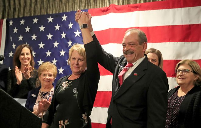 Erie County GOP Chairman Karl Simmeth congratulates Deborah Haendiges at Republican headquarters at the Avant on Tuesday, Nov. 5, 2019. (Harry Scull Jr./Buffalo News)