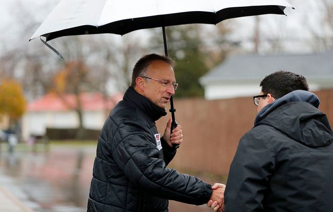 West Seneca supervisor candidate Gary Dickson greets voters at the Reserve Hose Fire House on Berg Road in West Seneca on Tuesday, Nov. 5, 2019. (Mark Mulville/Buffalo News)