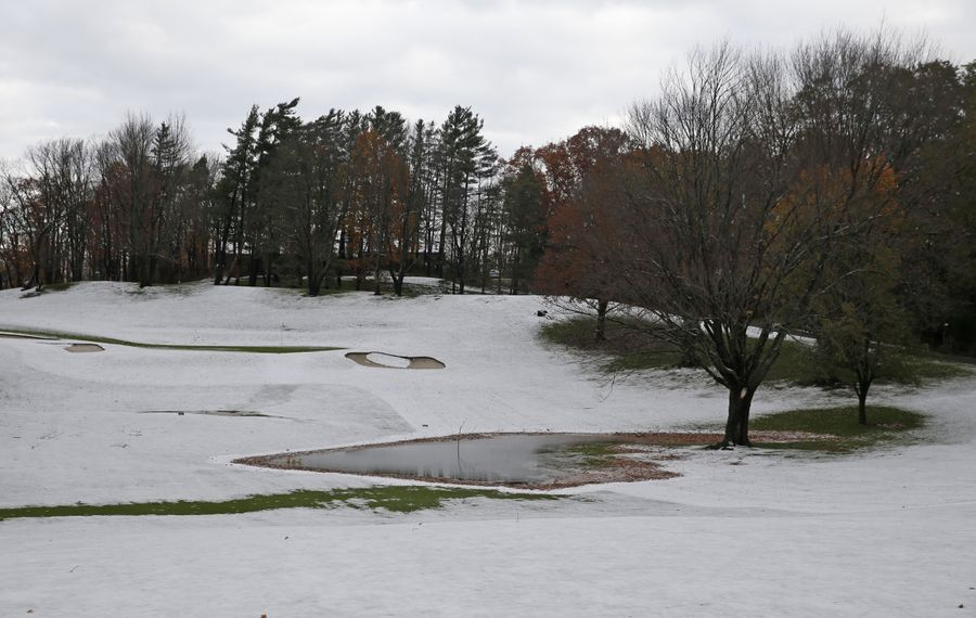 A light snow decorated the  golf course at the East Aurora Country Club.  While Farmers Almanac predictions are popular in some quarters, meteorologists say such long-range forecasts can not be accurate. (Robert Kirkham/Buffalo News)