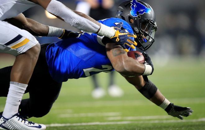 University at Buffalo running back Jaret Patterson fights for yards against Toledo during the second half of a college football game at UB Stadium on Wednesday, Nov. 20, 2019.  (Harry Scull Jr./Buffalo News)