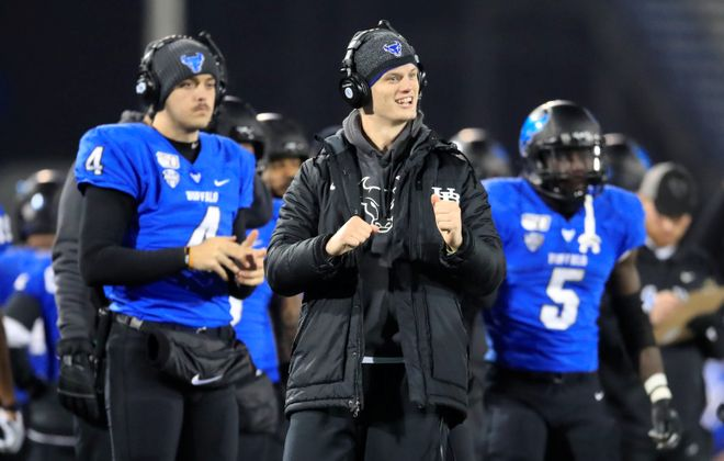 University at Buffalo quarterback Matt MYers cheers a Jaret Patterson touchdown against Toledo during the second half at UB Stadium on Wednesday, Nov. 20, 2019. (Harry Scull Jr./Buffalo News)