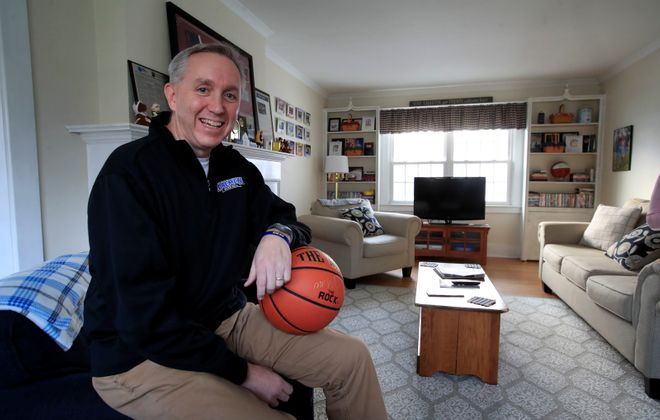 Daeman College men's basketball coach Mike MacDonald in his Amherst, NY home on Wednesday, Nov. 20, 2019.  (Harry Scull Jr./Buffalo News)