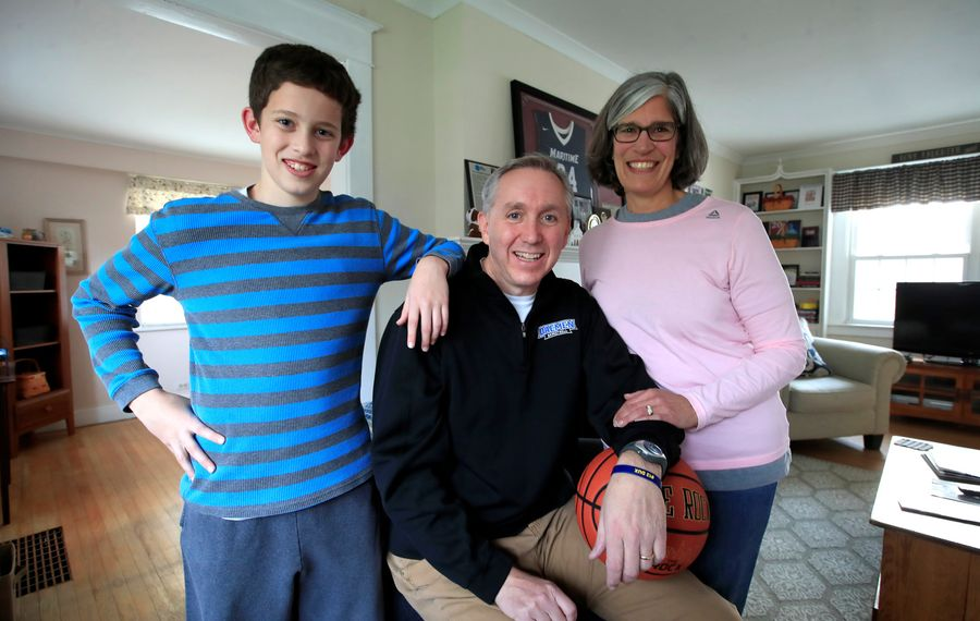 Daeman College men's basketball coach Mike MacDonald and his wife Maura and his son Mark in their Amherst, NY home on Wednesday, Nov. 20, 2019.  (Harry Scull Jr./Buffalo News)