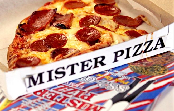 The mixed shapes of pepperoni are a notable difference on slices at Mister Pizza. (Robert Kirkham/Buffalo News)