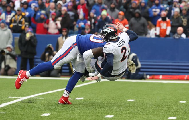 Bills defensive end Shaq Lawson plants Broncos quarterback Brandon Allen into the New Era Field turf during Sunday's game. (James P. McCoy/Buffalo News)
