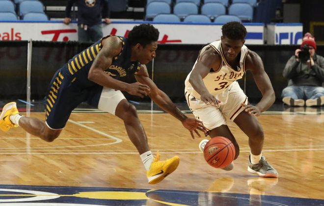 Canisius Golden Griffins guard Majesty Brandon (15) battles St. Bonaventure Bonnies center Amadi Ikpeze (32) for the ball in the second half at Keybank Center in Buffalo on Saturday, Nov. 23, 2019.  (James P. McCoy/Buffalo News)