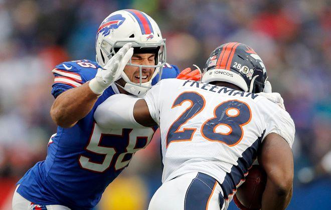Bills outside linebacker Matt Milano tackles Broncos running back Royce Freeman in the third quarter at New Era Field. (Mark Mulville/Buffalo News)