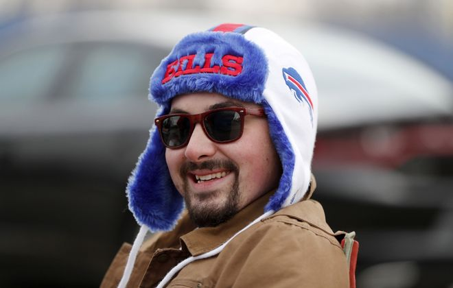 Chris Searles enjoys tailgating in the parking lot of New Era Field before the game with the Broncos on Sunday, Nov. 24, 2019.       (Mark Mulville/Buffalo News)