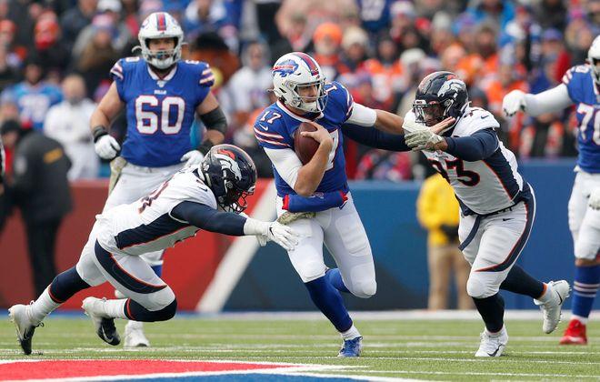 Josh Allen eludes Denver inside linebacker Todd Davis (51) and Denver Broncos defensive end Dre'Mont Jones (93) in the first quarter at New Era Field. (Mark Mulville/Buffalo News)