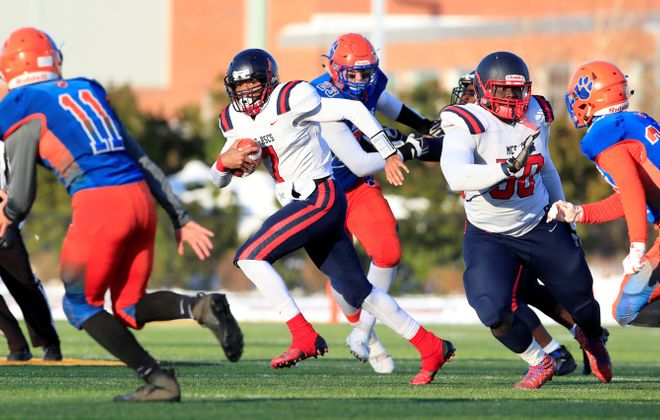 Western New York Maritime Charter/Health Sciences quarterback Jion Washington runs against Livonia during the first half of the New York State Class B Far West Regional High School football game at the State University College at Brockport on Saturday, Nov. 16, 2019. Harry Scull Jr./Buffalo News