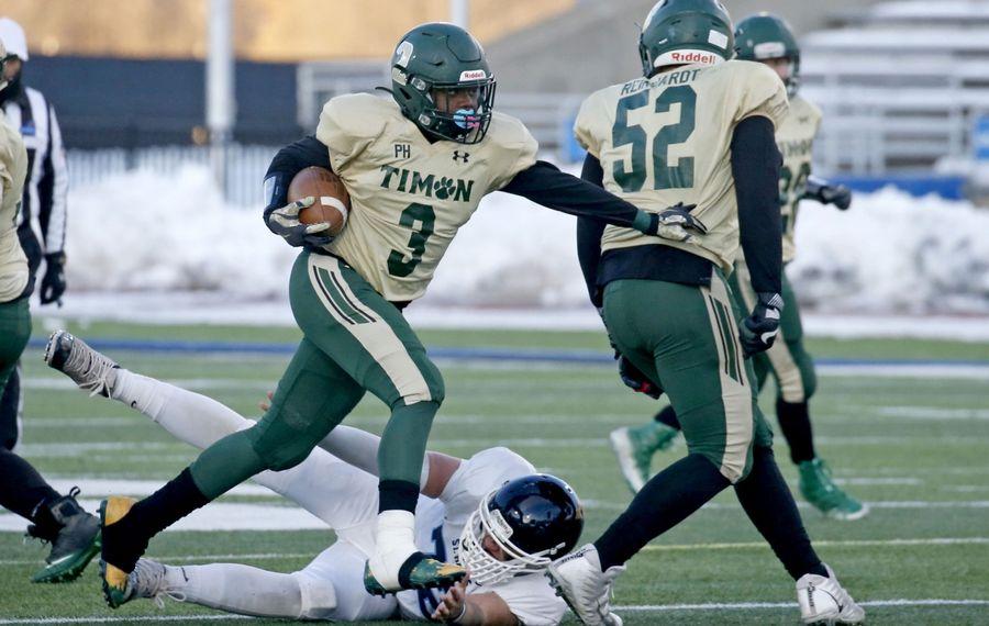 Timon's Brandon Laury (3) breaks through for some extra yards. (Robert Kirkham/Buffalo News)