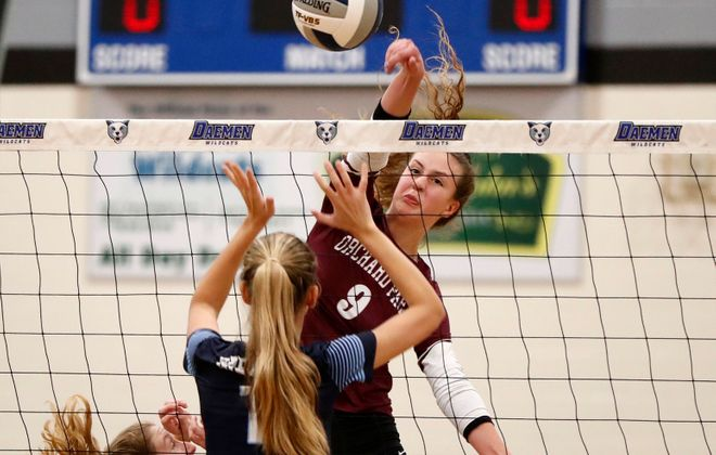 Orchard Park's Ashley Dogal puts the ball past Rochester Mercy's Makenna Casper in the Class AA Far West Regional match at Daemen College Sunday. (Mark Mulville/Buffalo News)