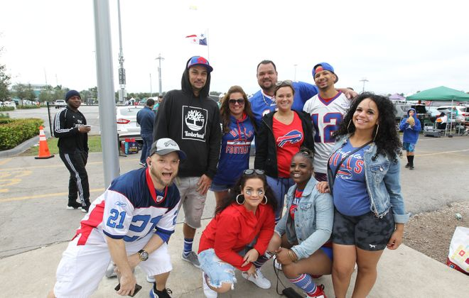 Buffalo Bills fans party in the parking lot before the game against the Dolphins at Hard Rock Stadium in Miami Gardens, Fla. (James P. McCoy/Buffalo News)