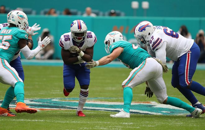 Buffalo Bills running back Frank Gore (20) rushes for a first down against Miami Dolphins outside linebacker Jerome Baker (55) in the second quarter at Hard Rock Stadium on Sunday, Nov. 17, 2019. (James P. McCoy/Buffalo News)