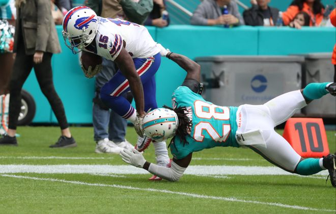 Bills' John Brown catches a pass in front of safety Bobby McCain for a touchdown in the second quarter of Sunday's win over the Dolphins. (James P. McCoy/Buffalo News)