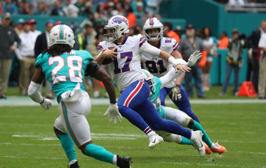 Buffalo Bills quarterback Josh Allen rushes for a first down Sunday. (James P. McCoy/Buffalo News)