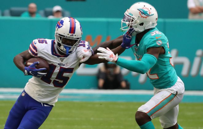 Bills wide receiver John Brown (15) rushes for a first down against Miami Dolphins cornerback Ken Crawley. (James P. McCoy/News file photo)