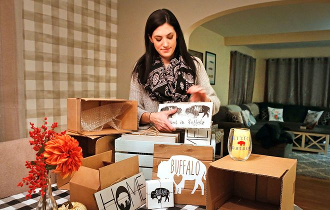 Katie Cipollone, owner of Etsy site CipShopBflo, packages some of her most popular items as she prepares them for shipping.  (Robert Kirkham/Buffalo News)
