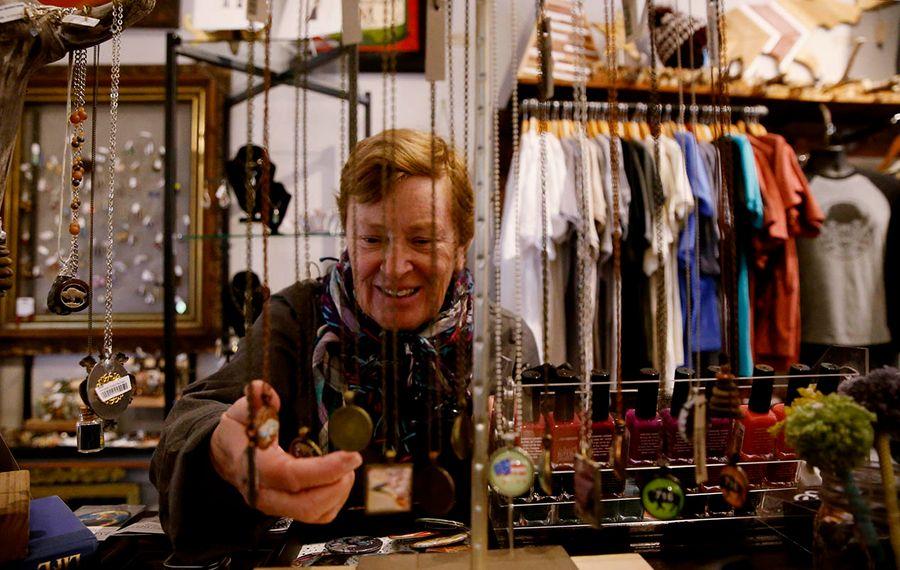 Cindy Metzen, of Buffalo, looks at jewelry at ShopCraft as she does Christmas shopping on Elmwood Avenue in Buffalo on Saturday, Saturday, Nov. 30, 2019. (Sharon Cantillon/Buffalo News)