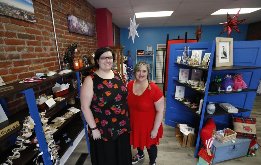 Talia Kalisiak, 19, left, stands in her shop Handmade WNY in North Tonawanda with her mom, Heather Kalisiak, who owns Martinsville Soapworks just a few doors down. (Sharon Cantillon/Buffalo News)