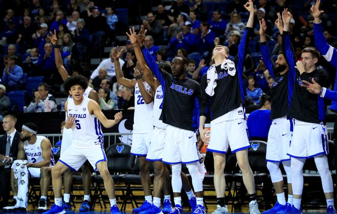 University at Buffalo players celebrate a three point basket against William & Mary during the second half of a college basketball game at Alumni Arena on Saturday, Nov. 30, 2019.  (Harry Scull Jr./Buffalo News)