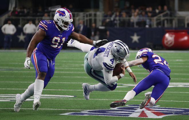 Buffalo Bills defensive tackle Ed Oliver (91) and Buffalo Bills cornerback Taron Johnson (24) stops Dallas Cowboys quarterback Dak Prescott (4) short of a first down in the fourth quarter at AT&T Stadium in Arlington, TX on Thursday, Nov. 28, 2019.  James P. McCoy/Buffalo News
