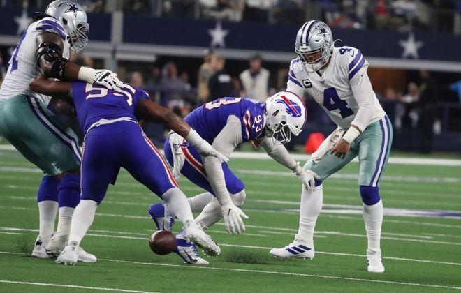 Bills defensive end Trent Murphy forces a fumble by Cowboys QB Dak Prescott  at AT&T Stadium in Arlington on Nov. 28. (James P. McCoy/Buffalo News)