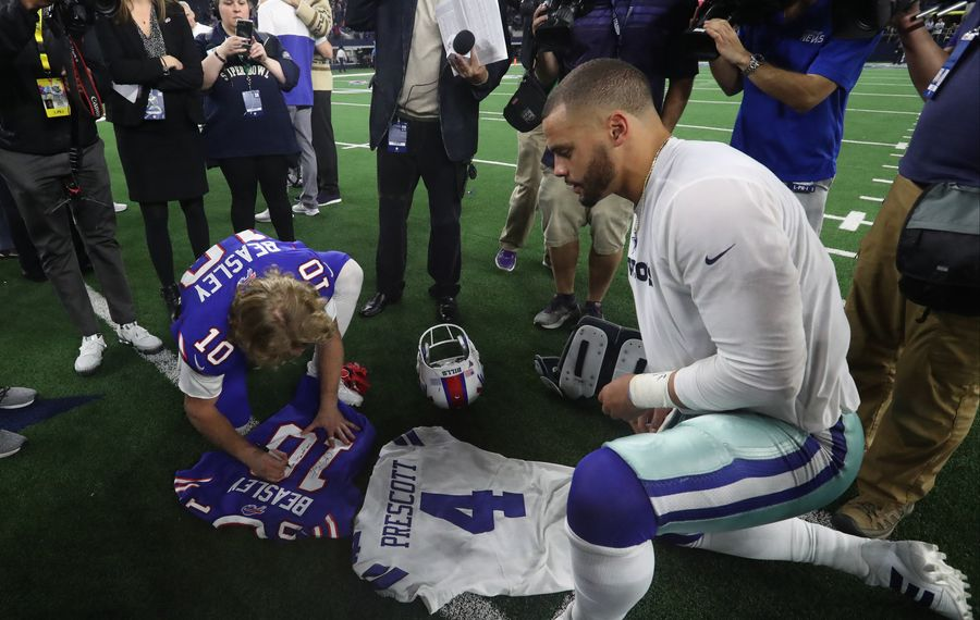 Bills wide receiver Cole Beasley and Dallas Cowboys quarterback Dak Prescott exchange jerseys after the game. (James P. McCoy/News file photo)