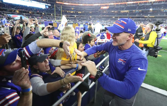 Bills coach Sean McDermott greets fans as he leaves the field after beating the Dallas Cowboy 26-15 at AT&T Stadium. (James P. McCoy/Buffalo News)