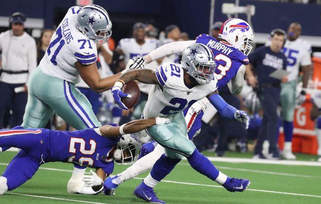 Bills cornerback Kevin Johnson tackles Cowboys running back Ezekiel Elliott.  (James P. McCoy/Buffalo News)