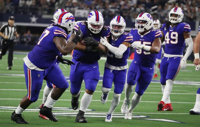 Bills defensive tackle Star Lotulelei (98) intercepts the ball in the second quarter against Dallas on Thanksgiving. (James P. McCoy/Buffalo News)
