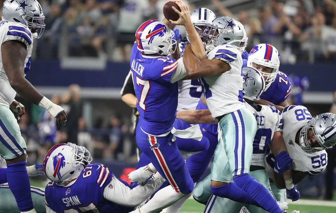 Buffalo Bills quarterback Josh Allen (17) dives in for the first down after recovering his on fumble in the second quarter of last season's Thanksgiving Day game against the Dallas Cowboys. (James P. McCoy/Buffalo News)